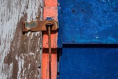 Weathered Juxtaposition ... (vanessa violet) Tags: blue trueblue colourfusion colour orange weathered wood rust hinge weatheredjuxtaposition justaposition texture