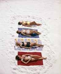 Women modeling two-piece bathing suits at Pensacola Beach (State Library and Archives of Florida) Tags: tallahassee florida women models bathingsuits beaches sunbathing