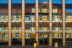 Mirrors (Slav.Burn) Tags: architecture mirrors toruń yellow building glass reflection poland
