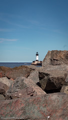 Duluth Lakewalk (Lizzy Anderson Photography) Tags: minnesota unitedstates us duluth park lakewalk duluthlakewalk lighthouse lakesuperior water rock sky