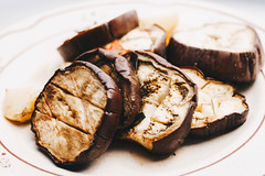 Slices of eggplant roasted in a grill (wuestenigel) Tags: garlic sauce oil dish roasted background healthy aubergine diet parsley delicious cooked isolated herb vegetable eating cooking fried meal grilled plate vegetarian baked tasty fresh eggplant grill view dinner prepared pan cuisine lunch appetizer snack gourmet food rustic organic