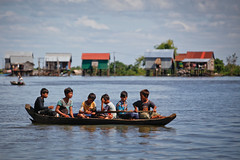 Boys on Kampong Khleang (Lil [Kristen Elsby]) Tags: cambodia canon5dmarkii kampongkhleang siemreap tonlesap travel travelphotography editorial cambodian khmer floodedvillage topf75 topv4444