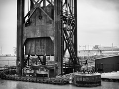 The Iron Curtain (HJharland5) Tags: bridge river water vertical lift metal truss bank shore shoreline cleveland ohio theflats historic monochrome rails railroad tracks locomotive