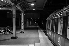 Enter the frame / late night ride (Özgür Gürgey) Tags: 2018 50mm bw d750 nikon architecture bike grainy lines lonely lowlight people platform station street train istanbul photingo