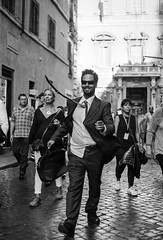 Blown away (Bruno Naredo) Tags: portrait filmisnotdead filmphotography kodaktmax400 tmax kodak canon analogue analogphotography analog schwarzweiss blancoynegro blackandwhite streetview streetportrait rome rom roma italia italien italy street travel 50mm retrato piazzanavona navona