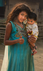 tharu kid with baby (trying to catch up again !!!) Tags: kid baby chitwan tharu outside portrait poor posing nepali nepal nationalpark chitwannationalpark village backlight ivodedecker terai travel streetphotography streetlife socialphotography