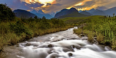 Drakensberge - Cathedral Peak view (memories-in-motion) Tags: southafrica drakensberge cahtedral peak river nature green grass mountains red orange sunset panorama landscape photography whitewater canon clouds light flow stones rock rsa ef1740mm 5dmarkiv