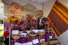 RTB Director, Graham Thiele, meets with two potato farmers at their stall in Cusco, Peru at the World Potato Congress. Photo: H.Holmes/RTB