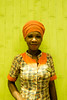 Monica (JulienLec) Tags: africa lieux ghana beauty waitress tamalé turban orange vert monica wooden