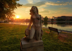 A Golden Granite (henriksundholm.com) Tags: sculpture statue morning female woman allegory sunset sunbeams sun strömsholmen park city urban landscape lake eskilstunaån bench shadows reflections tree hdr eskilstuna sverige sweden nude naked breasts boobs tits erotic sensual