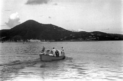040569 23 (ndpa / s. lundeen, archivist) Tags: nick dewolf nickdewolf blackwhite photographbynickdewolf bw 1969 1960s 35mm film monochrome blackandwhite april usvi virginislands usvirginislands stthomas charlotteamalie caribbean harbor port watersedge stthomasharbor hills waterfront ship ships boat boats sky clouds people sailors usn usnavy navy naval destroyer navyship usscone dd866 866 uniform uniforms uniformed whites americanflag american smallboat transportboat unitedstatesnavy flag