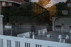Skagen sunset (Mona_Oslo) Tags: restaurant window reflections sunset houses closed stair yellow monajohansson