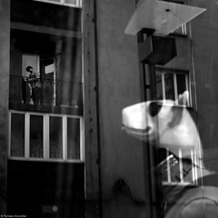 Chorzów 2018 (teesz80) Tags: reflection odbicie window okno człowiek people bw noir monochrome street photo ulica streetphoto miasto town city polska poland balkon balcony postać character man