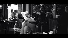 [ Duty Free ] (Visual Flows) Tags: visualflows cinematography 2018 cinematic duty free amsterdam man newspaper wine pub cafe sunshine street streetphotography blackandwhite black white