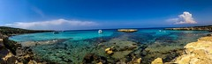 Blue Lagoon Cyprus (Mad Cow Imagery) Tags: rock beach bay seascape landscape boats clouds sky rocks water ocean sea springtime spring holiday mediterranean europe panorama mobilephotography appleiphonex iphonexphotography iphonephotography bluelagoon paphos cyprus