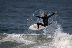Small wave, big air (bodro) Tags: droplets midair ocean splash spreadeagle surfboard surfing wave