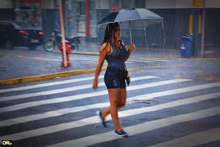 Lonely girl under a hard rain