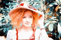 Sweet young hispanic lady portrait (Riccardo Trevisan) Tags: settecento costumiatema themes costumidepoca abitidepoca 18thcentury 18thcenturystyle 18thcenturyfashion lady ragazza pale darkeyes hispanic latina orange hat cappellino capelli capelliricci curlyhair