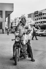Hardworking Dad (PinoyOpsJawo) Tags: motorcylce bike mono monochrome niftyfifty 50mm nikonphotography nikon nikond5300 bw blackandwhite people streetphotography street father work job car bus roa road nonhdr portrait