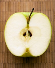 Stock Images (perfectionistreviews) Tags: color vertical studio stilllife indoors nobody produce diet fruit healthy health nutritional nutrition food apples apple grannysmith greenapple seeds seed halved half core cut snack closeup natural foodanddrink