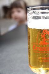 Curiosity (Rambling Badger) Tags: cordoba spain andalusia city child curious drink beer glass cruzcampo froth