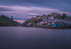Before the sun hides beneath the clouds (Wizard CG) Tags: long exposure landscape epl7 england architecture ed bristol ngc world trekker micro four thirds 43 m43 olympus mzuiko digital tourist attraction outdoor bridge clifton suspension longexposure sunset skyline river water nd filter sky boat building tree dusk grass