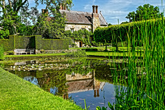 Bateman's House (Geoff Henson) Tags: rudyardkipling house nationaltrust pond reflection tree hedge water sky green blue roof chimney fish goldfish