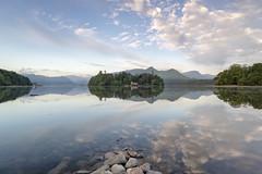 Derwent Dawn. (miketonge) Tags: derwentwater keswick catbells derwentisland nisi lakedistrict reflections water rocks