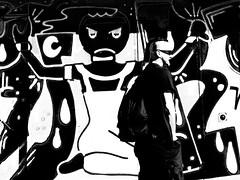 black and white view (nika.vero) Tags: bw black blackwhite monochrome contrast faces city graffity art street streetart wall building people look glasses view