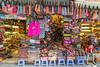 A Street Market in Hanoi (Jill Clardy) Tags: asia hanoi vietnam 201410124b4a7513 street market bright neon colors stools shopkeeper bored girl junk dong xuan old quarter goods commerce shop shopping