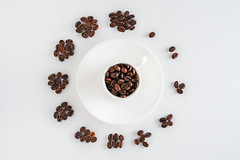 cup of coffee on saucer and coffee beans in form of a clock (sasske_kun) Tags: concept clock coffee time background watch white cup morning hour food break business symbol drink coffeecup work view cafe creative breakfast closeup sign top minute black design aroma life illustration number object office rest espresso mug vintage bright circle round table simple still free beautiful