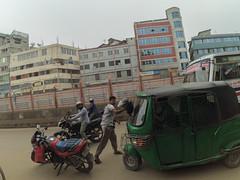 Dhaka Street #182 Angry Man (سلطان محمود) Tags: dhaka dhakastreet999 bangladesh xiaomi yi action visited chaos city ramadan day angry man cng bike helmet building roadside outdoor colo color