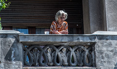 2018 - Romania - Bucharest - The Balcony (Ted's photos - Returns 23 Jun) Tags: 2018 bucharest nikon nikond750 nikonfx romania tedmcgrath tedsphotos vignetting balcony railing lady female aged old oldlady senior person one bucharestromania bucuresti
