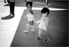 Cool Kids Never Sleep (Steve Lundqvist) Tags: teramo italy italia italiano street streetphotography shot monocromo persone man monochrome candid walking age people blackandwhite bw sidewalk marciapiede snap vivian maier world outside leica q child bambini children young childhood youth