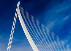 Take me to the bridge (Adaptabilly) Tags: lines blue travel spain bridge valència triangle sky structure ciudaddelasartesylasciencias architecture cityofartandscience santiagocalatrava lumixgx7 clouds europe