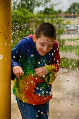 Dancing in the Droplets (flashfix) Tags: may272018 2018inphotos ottawa ontario canada nikond7100 40mm flashfix flashfixphotography droplets splashpad child childhood waterpark tiedye water portrait