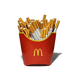 mcfries. now healthier (brescia, italy) (bloodybee) Tags: mcdonalds fastfood junkfood fries frenchfries chips food health healthyfood smoke smoking tobacco cigarette stilllife humor fun logo brand corporation red