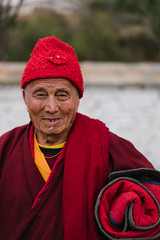 Belonging (A. adnan) Tags: bhutan travel paro portrait travelphotography red santa hat oldman