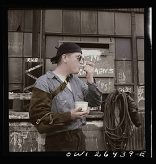 Stepping out of time A welder eating ice cream (rob.vndnB) Tags: maryland library congress colorization colorized photo siegel arthur photogragh photographs picture public old rvndnb archives border looking light nitrate negatives image print year 1943 bethlehem fairfield shipyards baltimore