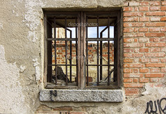 Old window with iron bars at home in ruins (ruggerotaschini) Tags: aged ancient antique architectural architecture background bars brick building buildingexterior builtstructure cell closed detail door dungeon exterior frame grate home house iron jail lattice locked metal nobody obsolete old prison prisoncell rust rusty safety secure security steel stone wall weathered window