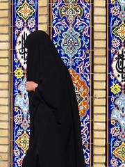 Tehran Street (RobertLx) Tags: iran tehran tajrish imamzadehsaleh mosque middleeast asia woman people black wall contrast dailylife street passing walking chador tiles mosaic colour muslim islam shia