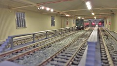 Third Rail in the Shed. (ManOfYorkshire) Tags: 176 scale model railway emu electric unit thirdrail oogauge portsoton victory portsmouth exhibition 2018 shed lit illuminated detailed carriagesidings walkway diorama
