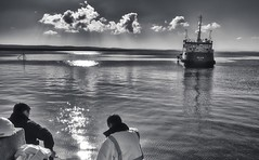 Selkie sets out (Tom McPherson) Tags: landscape light london mine mobile mountain mountains nature new night ocean old park people photo pink red reflection river school scotland sea sign sky spring streetart boat dredger selkie water seascape burghead sun waves ship ripples mono blackandwhite monochrome evenoinig evening clouds rays workmen men watching life