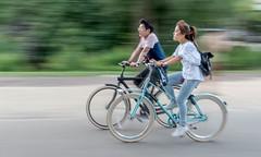 Eyes Closed (matthew:D) Tags: blur lighting people vondalpark two background ridingbike man twopeople dutch motion woman bikes panning netherlands amsterdam shutterspeed