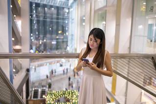 Singaporean woman waiting in shopping mall