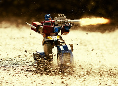 Optimus Charges into Battle (Jezbags) Tags: optimus charges battle toy toys macro macrophotography macrodreams canon canon80d 100mm closeup upclose motion dust rocks gun fire sepia transformer prime hottoys