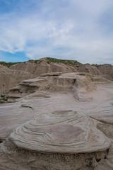 Geological Oddities (Nancy King Photography) Tags: nebraskapanhandle landscape oglalanationalgrassland sandstone hills sky clouds toadstoolnationalgeologicalarea badlands nebraska rocks
