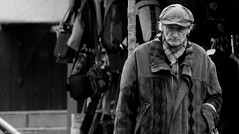 Rainy Days and Miserable Men (Neil. Moralee) Tags: neilmoralee neilmoraleenikond7200 man hat coat rain raining old mature walking shopping scarf cold wet street candid weather storm wind black white bw bandw blackandwhite mono monochrome neil moralee nikon d7200