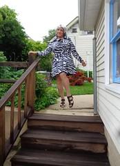 Watch That First Step, Laurette . . . (Laurette Victoria) Tags: legs sandals raincoat silver laurette woman