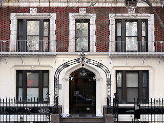Neo-Gothic entrance with a wrought iron entry arch, Gramercy Court (1907), 142-156 East 22nd Street, Manhattan